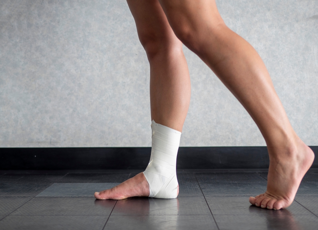 Image of sharp ankle pain when walking with a bandaged ankle also.