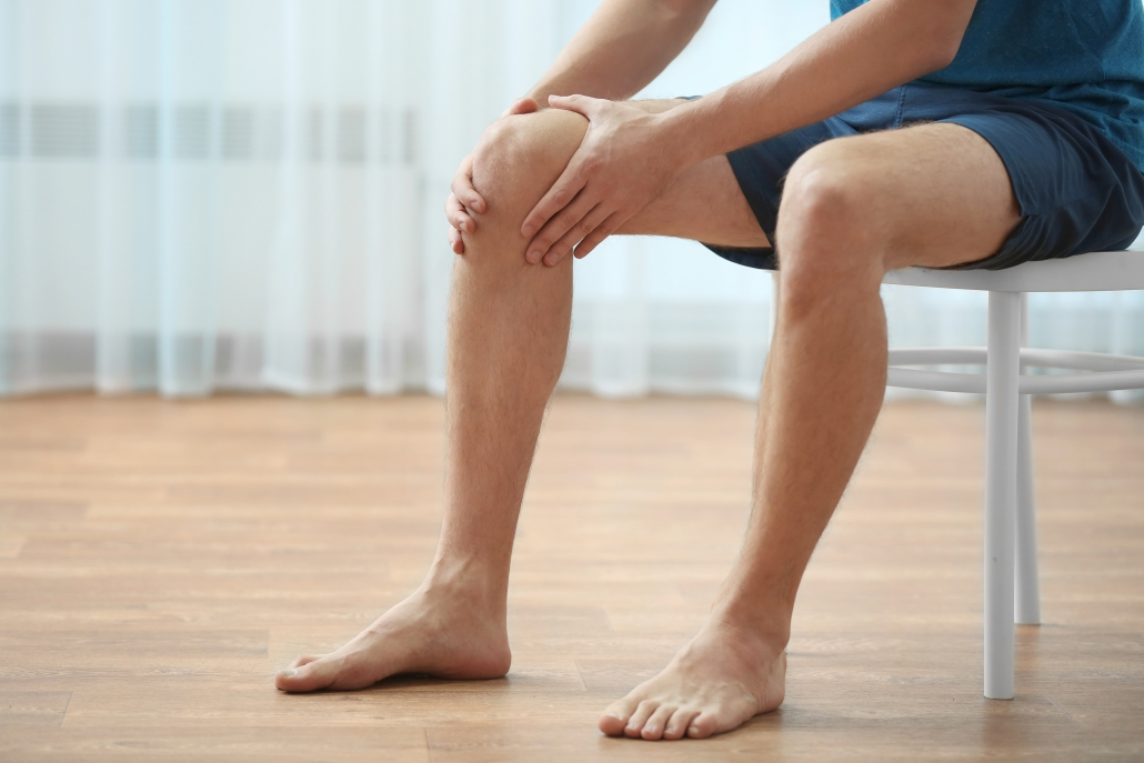 Image depicting stubborn knee pain requiring support from custom orthotics.